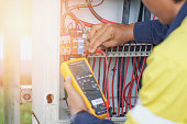 istock Workers use a Multimeter to measure the voltage of electrical wires produced from solar energy to confirm systems working normally 1192062102