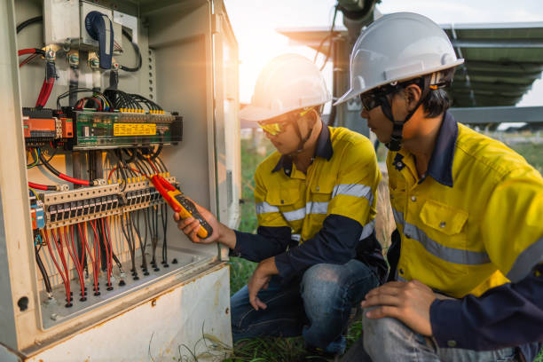 workers use clamp meter to measure the current of electrical wires produced from solar energy for confirm to normal current - eletricidade imagens e fotografias de stock