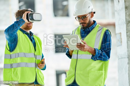 534196421istockphoto Workers Using Visual Simulation on Site 1035457580