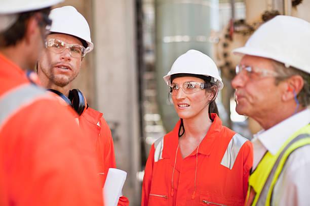 workers walking at oil refinery - arbetssäkerhet bildbanksfoton och bilder