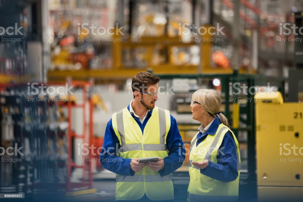 Workers Walking Through a Factory stock photo