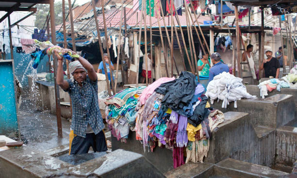 Workers washing clothes at Dhobi Ghat in Mumbai, Maharashtra, India stock photo