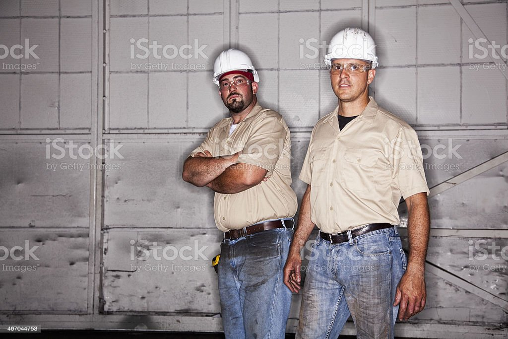 Workers wearing hardhats stock photo