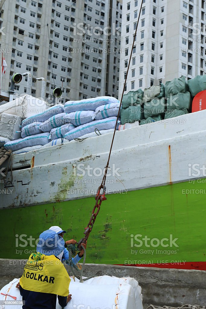 Workers were transporting the goods to the ship stock photo