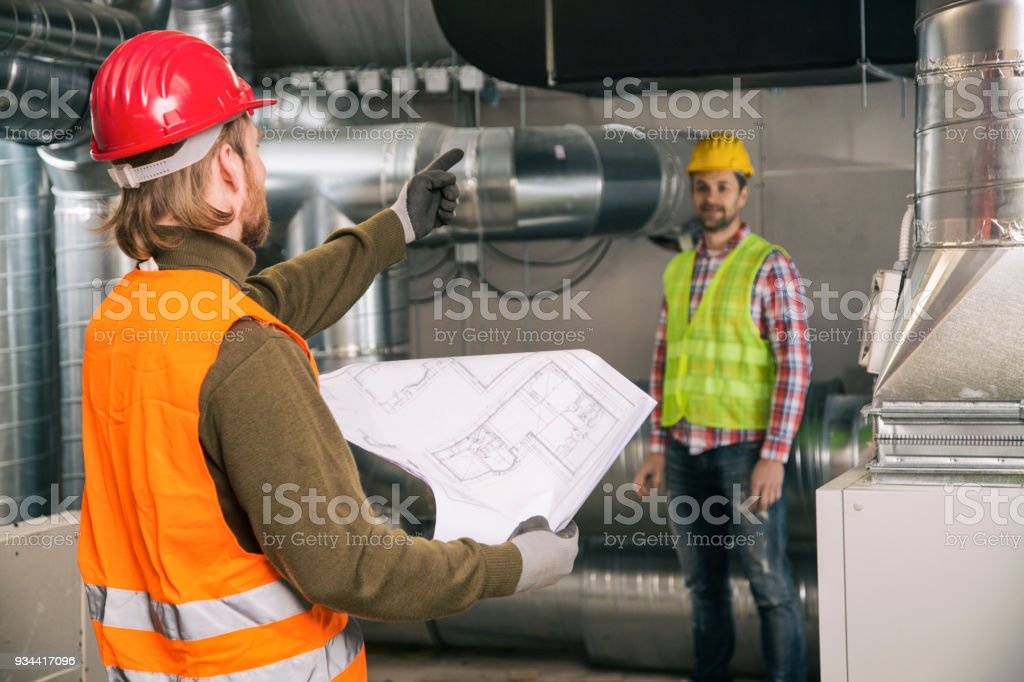 Workers with blueprint stock photo