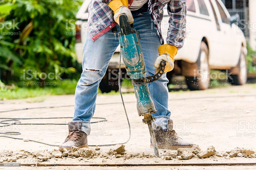 Workers with Concrete Breaker Electric stock photo