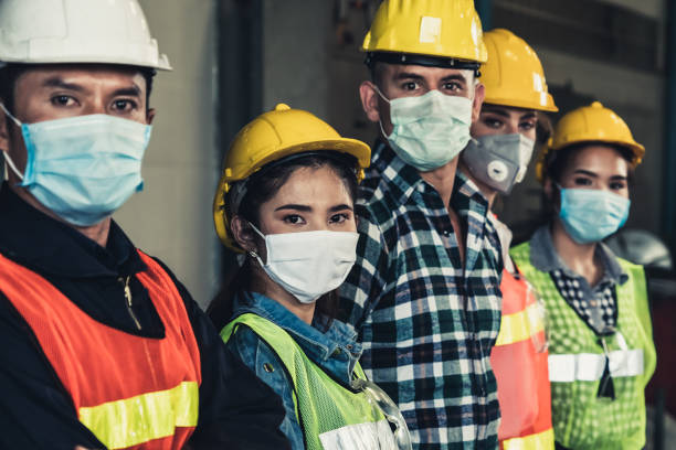 Workers with face mask protect from outbreak of Corona Virus Disease 2019. Factory workers with face mask protect from outbreak of Corona Virus Disease 2019 or COVID-19. covid mask stock pictures, royalty-free photos & images