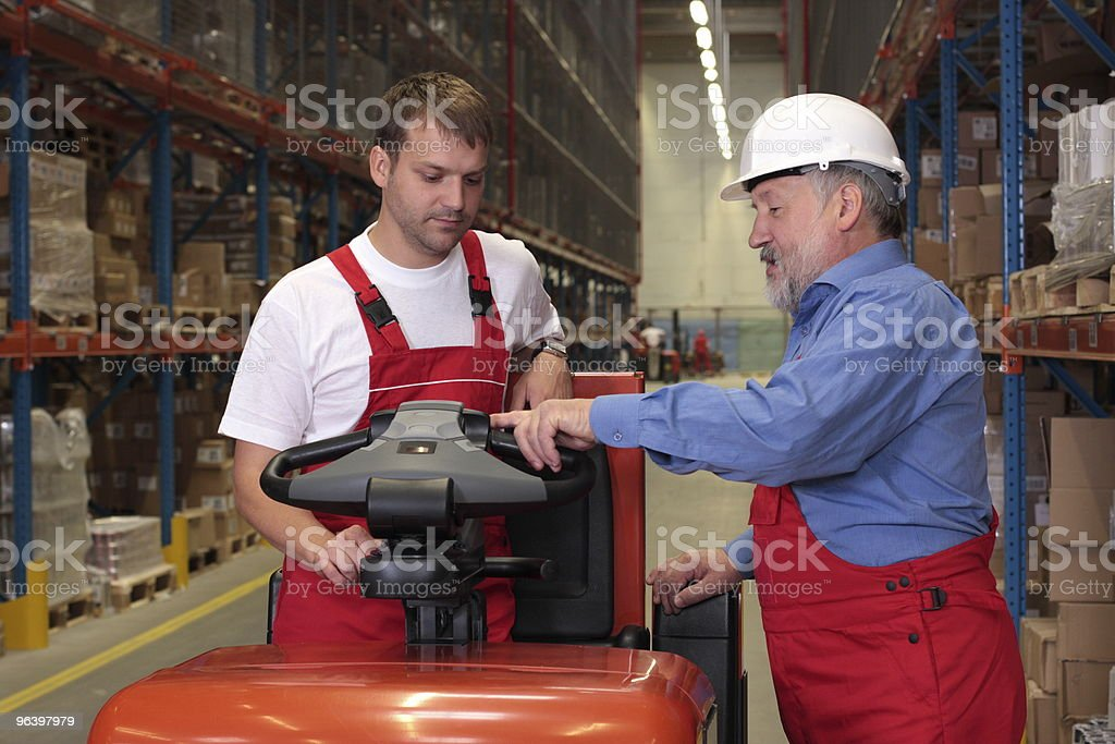 workers with forklift in factory stock photo