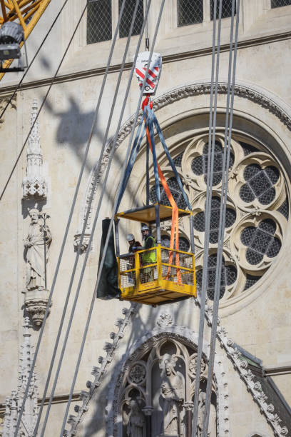 Workers with tall cranes fixing Zagreb Cathedral tower stock photo