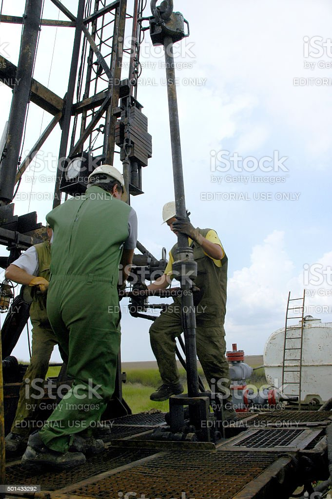Workers work in the field of oil and gas stock photo