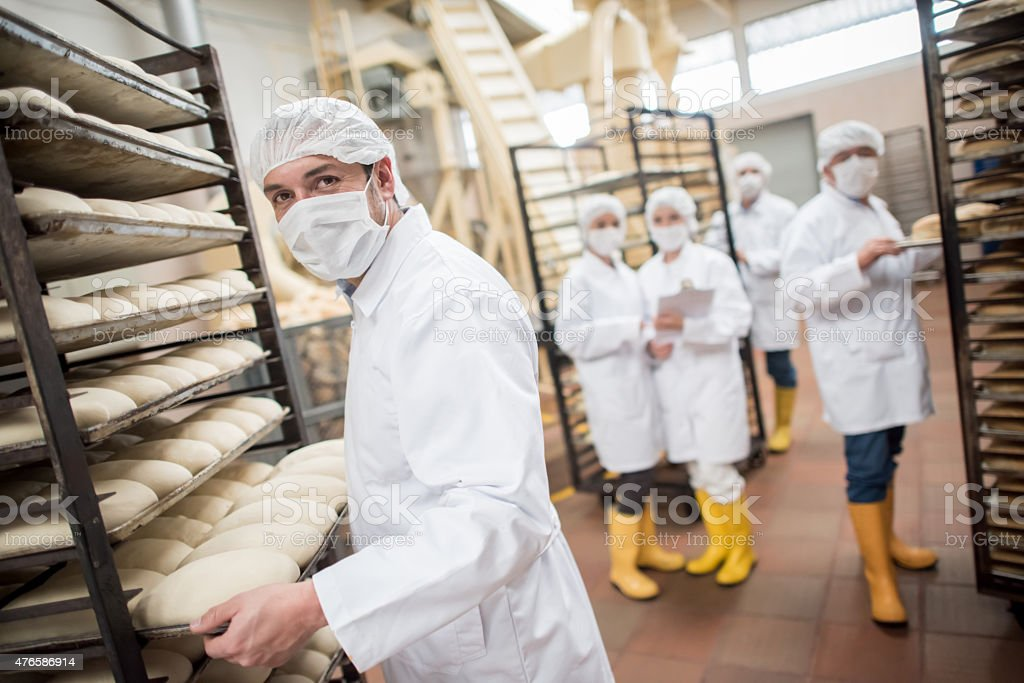 Workers working at a food factory stock photo