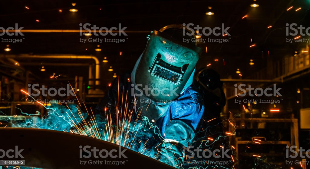 Worker,welding in a car factory stock photo