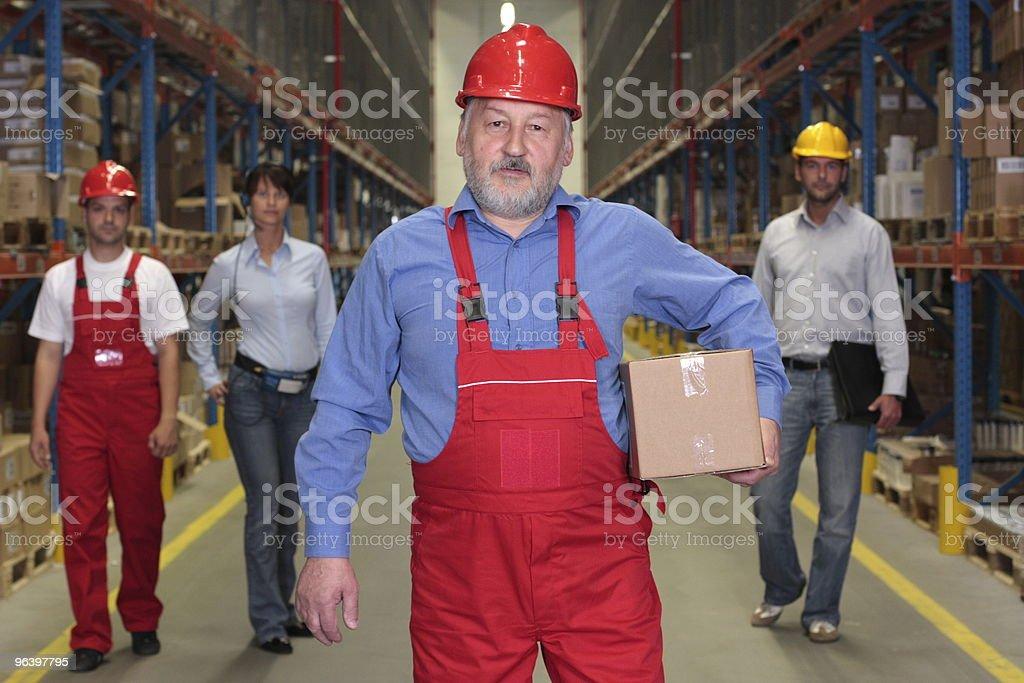倉庫の従業員は、経験豊富なフロント - 4人のロイヤリティフリーストックフォト