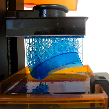istock Working 3D printer. Electronic three dimensional printing machine in process. 1142399006