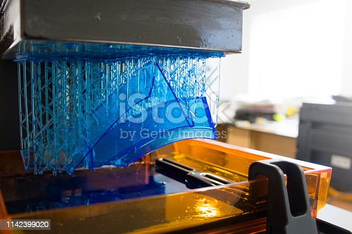 istock Working 3D printer. Electronic three dimensional printing machine in process. 1142399020