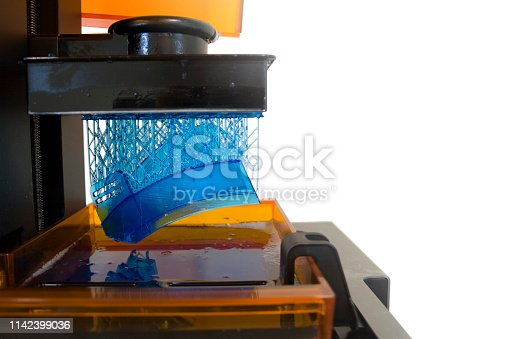 istock Working 3D printer. Electronic three dimensional printing machine in process. 1142399036