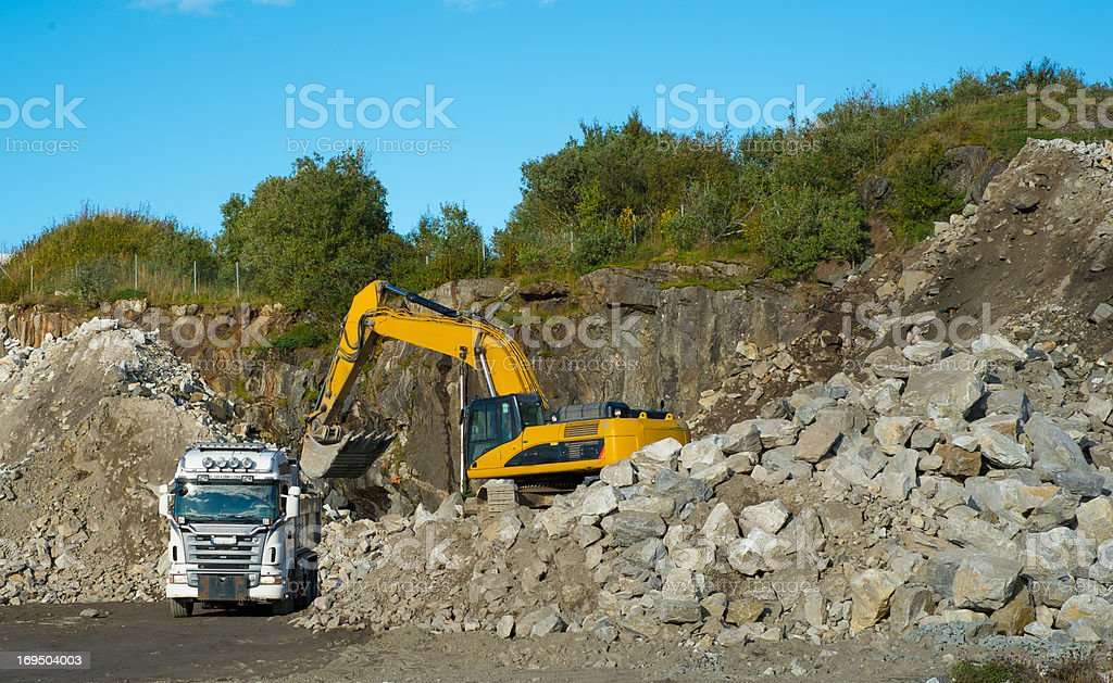 Working a granite quarry stock photo