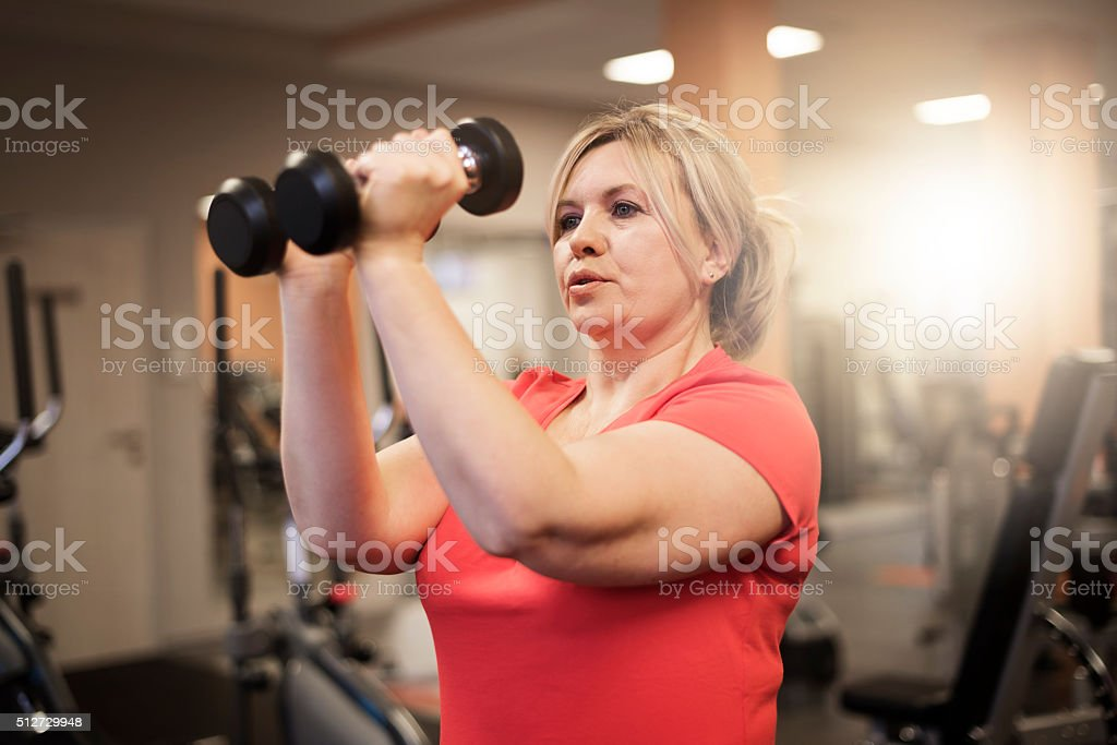 Working arms at the gym stock photo