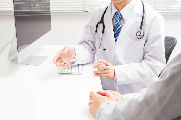 作業アジア医師 - 医院 ストックフォトと画像