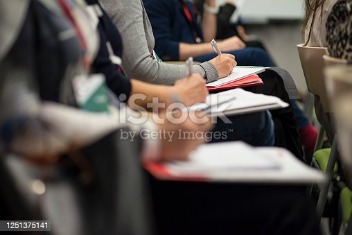1028234706 istock photo Working at a business congress. 1251375141