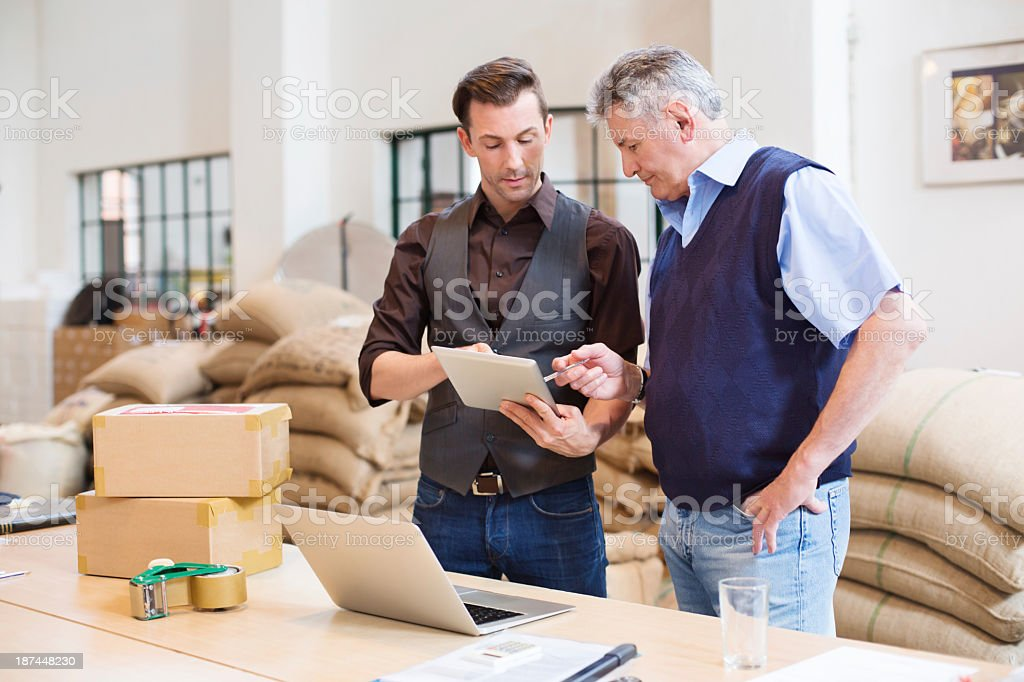 Working at a coffee storage room stock photo