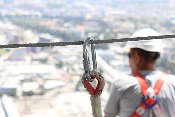 Working at a construction site Safety Equipment In Use safety harness stock pictures, royalty-free photos & images