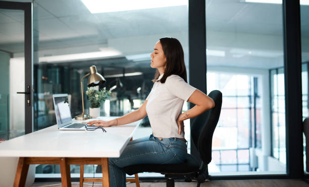 Working at a desk all day isn't good at all stock photo