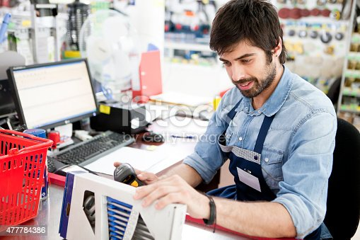 Man working at pay desk in hardware store