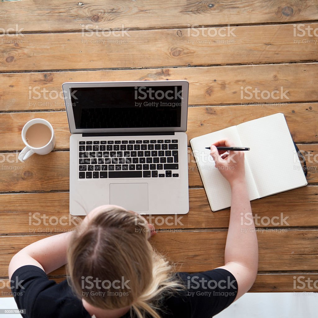 working at a laptop from above royalty-free stock photo