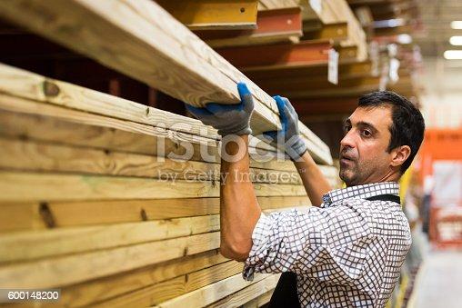 mature man Working at a timber/lumber warehouse