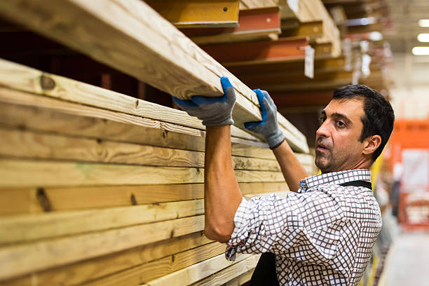 Working at a timber/lumber warehouse mature man Working at a timber/lumber warehouse immigrant stock pictures, royalty-free photos & images