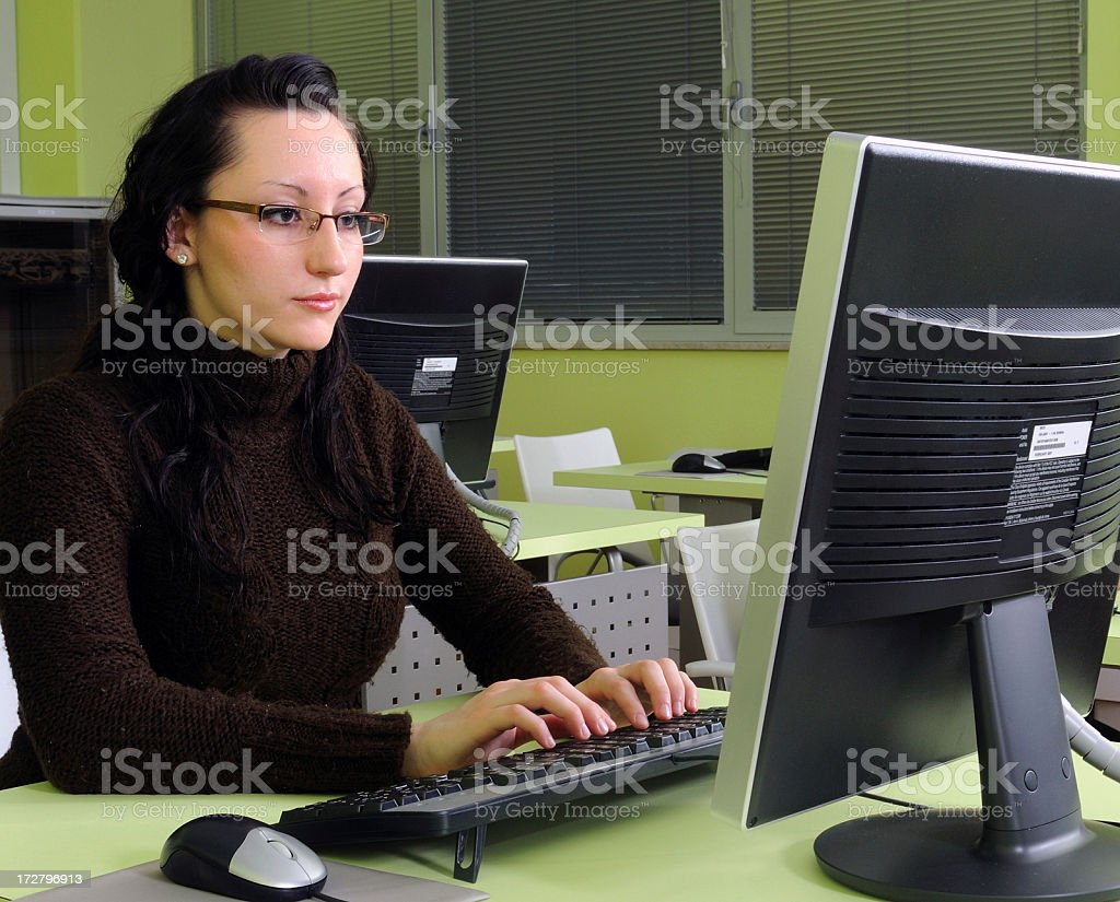 Working at computer royalty-free stock photo