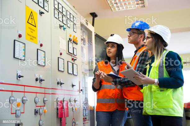 Working At Energy Control Room Stock Photo - Download Image Now