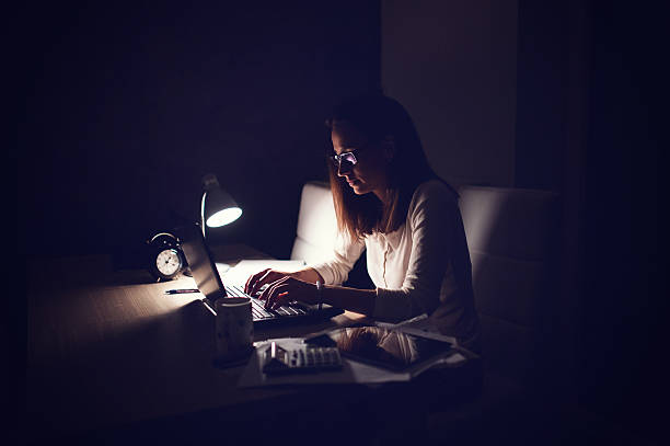 working at home - low lighting stock photos and pictures