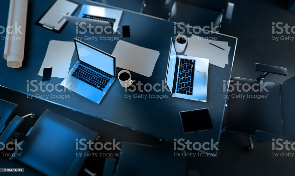 Working at night with laptop computers on office desk stock photo