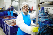 istock Working at seafood plant 905698382