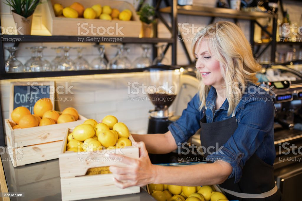 Working at smoothie cafe stock photo
