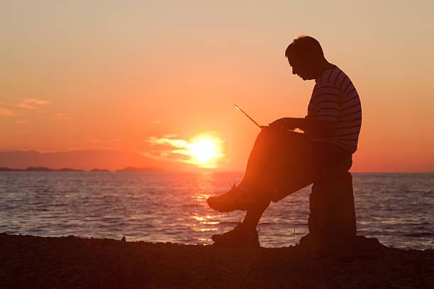 Working At Sunset stock photo