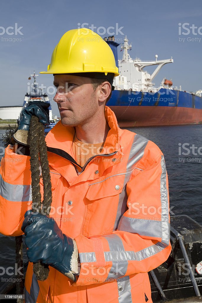Working at the harbor between big cargo ships. royalty-free stock photo