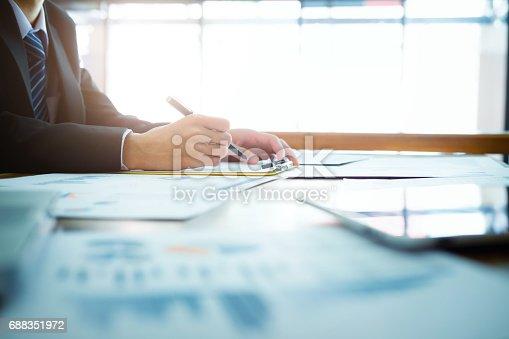 istock Working business people analyse high performance marketing data. 688351972