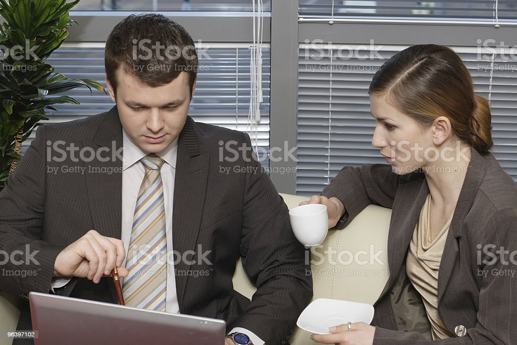 Working Business people sitting in the office and talking - Royalty-free Adult Stock Photo