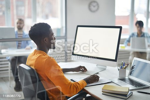 958531418 istock photo Working by computer 1135382770