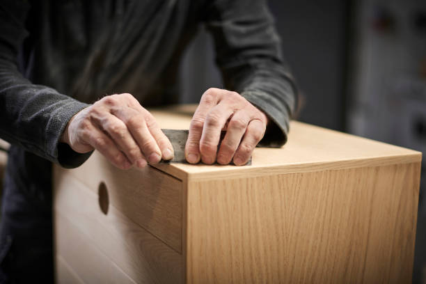 Working cabinetmaker and handmade furnitures stock photo