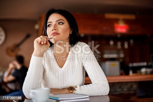 istock Working comfortably at a cafe 1137393189
