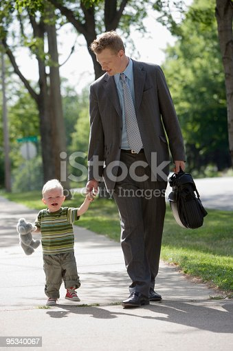 istock Working Dad walking with his son 95340067
