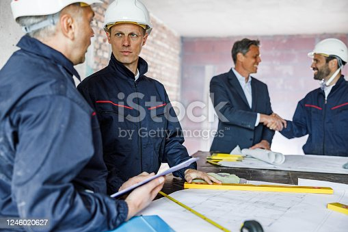 961745166 istock photo Working day at construction site! 1246020627