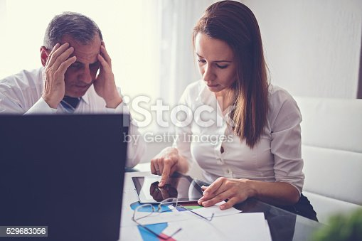 672116416istockphoto Working day at the office 529683056