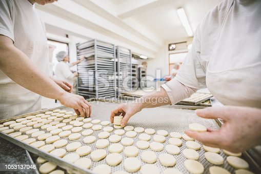 Group of women working together in bakery.