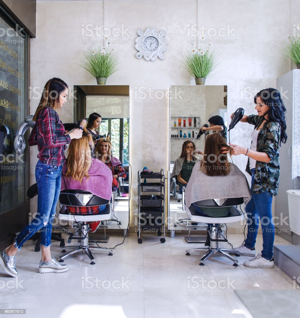 Working day inside the hair salon. stock photo