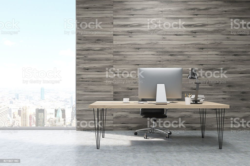 CEO working desk in office with wooden panels stock photo